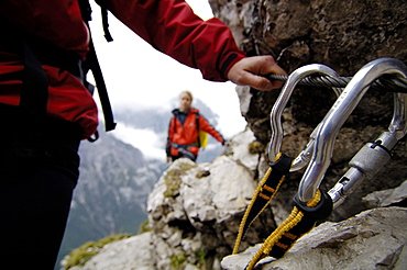Persons on fixed rope route, Hall in Tirol, Tyrol, Austria