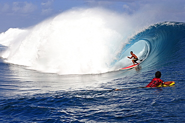 View to a barreling wave with surfers, Teahupoo, Tahiti, French Polynesien, South Pacific