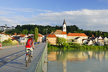 Female cyclist passing bridge over river Inn, Danube Cycle Route Passau Vienna, Passau, Lower Bavaria, Bavaria, Germany