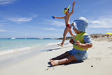 Children playing on the beach, Playa de Llevant, Formentera, Balearic Islands, Spain