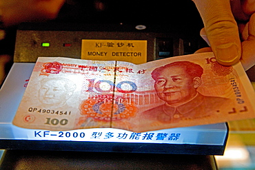 "Yuan, Renminbi (RMB) means ""The People's Currency"", bank note, portrait of Mao Tse Tung, fake, money detector, Chinese currency"