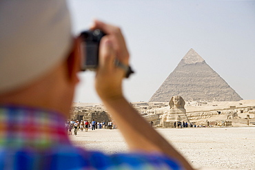Tourist Filming Sphinx and Chephren Pyramid,Pyramids of Giza, Cairo, Eqypt