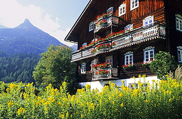 Traditional farmhouse with flower decorations, Kals, Glockner range, Hohe Tauern, East Tyrol, Tyrol, Austria
