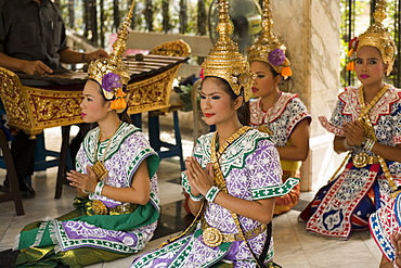 Traditional Thai dancers performing for Brahma, they dancing on request for donations, Erawan Shrine, Ratchadamri Road near Siam Square, Pathum Wan District, Bangkok, Thailand