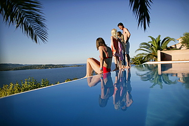 Family on poolside, Bay of Porto Vecchio, Southern Corse, France