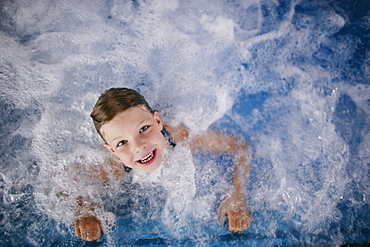 Young girl in whirlpool, Hotel Krallerhof, Leogang, Salzburger Land, Austria