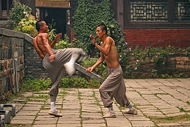 duel and training between two Shaolin monks, Shaolin Monastery, known for Shaolin boxing, Taoist Buddhist mountain, Song Shan, Henan province, China, Asia