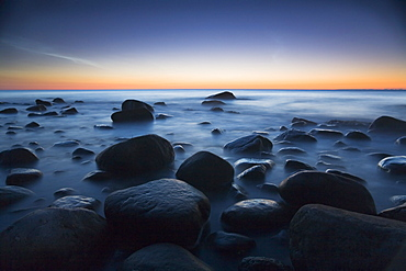 A rocky sea shore at dusk, Jasmund national park, Rugen Island, Mecklenburg Western Pommerania, Germany