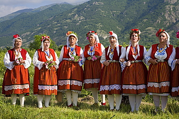 Singing women in traditional costumes at Rose Festival, Karlovo, Bulgaria, Europe