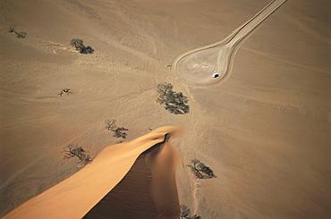 Car at Dune 45, aerial view over Namib Desert, Namibia