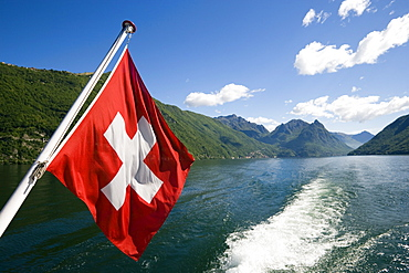 Motorboat with Swiss Flag on Lake Lugano, Lugano, Ticino, Switzerland