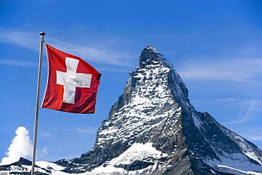 Swiss flag in front of the Matterhorn 4478 meters, Zermatt, Valais, Switzerland