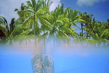 Maritius split level , feet unr water, palm trees