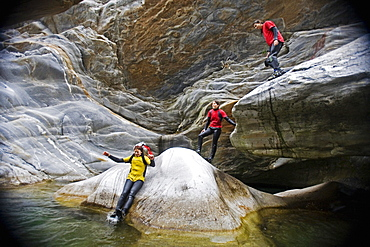 Young woman canyoning, Valle Maggia, Canton of Ticino, Switzerland, MR