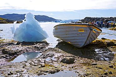 Stranded icebergs and a small boat at Narsaq, South Greenland
