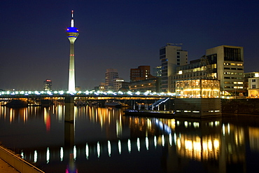 Modern architecture of the Media Harbour at night with television tower, Neuer Zollhof, Düsseldorf, state capital of NRW, North-Rhine-Westphalia, Germany