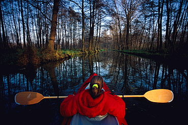 Woman canoeing on river Spree, Spreewald, Brandenburg, Germany