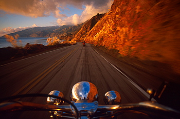 View over a handlebar at a motorbike on the highway 1, Cape San Martin, California, USA, North America, America