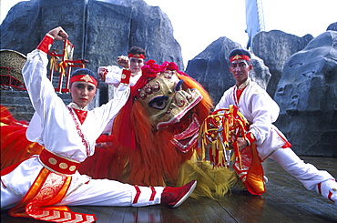 Dragon dance group, people in traditional costumes, Haw Par Villa, Singapore, Asia