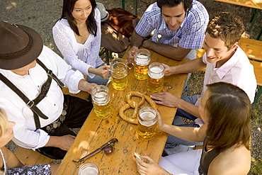 Medium group of people sitting at table in beer garden, Munich, Bavaria