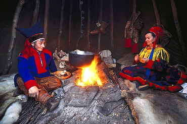 Lapps wearing traditional costumes at a bonfire, Mageroeya, Finnmark, Norway, Europe