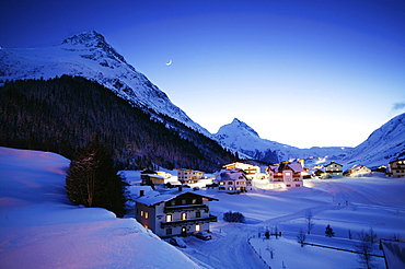 View over snow covered mountain village in at twilight, Galtur, Tyrol, Austria