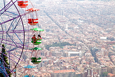 Ferris wheel on Tibidabo mountain with view over the city, Barcelona, Spain, Europe