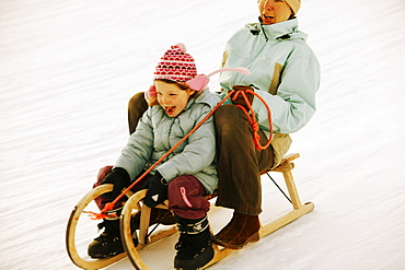 Mother and daughter sledding, Kuhtai, Tyrol, Austria