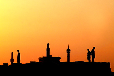 Silhouettes of people and minarets in the afterglow, Dubai Creek, Dubai, UAE, United Arab Emirates, Middle East, Asia