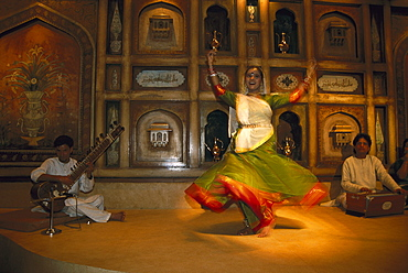 Dancer and musicians inside the Taj Mahal hotel, Dehli, India, Asia