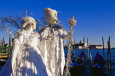 Two people in disguise at carnival, Venice, Italy, Europe
