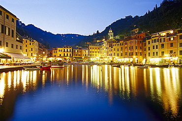 Illuminated restaurants at harbour in the evening, Portofino, Liguria, Italy, Europe