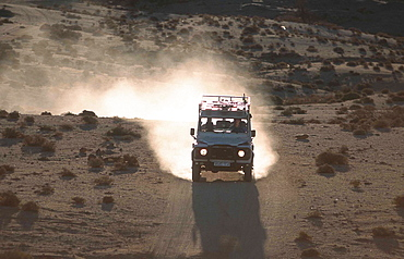 Off road vehicle on a desert road, Tafraout, Morocco, Africa