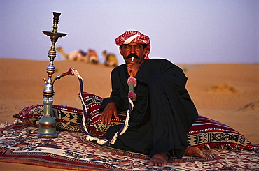Bedouin with shisha at the desert in the evening, Dubai, V.A.E., United Arab Emirates, Middle East, Asia