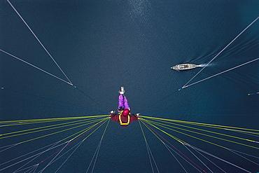 Paraglider gliding above a lake, Switzerland