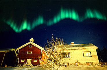 Northern lights above traditional wooden house, Lillehammer, Norway, Scandinavia, Europe