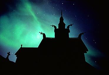 Northern lights above stavechurch, Borgund, More og Romsdal, Norway, Europe