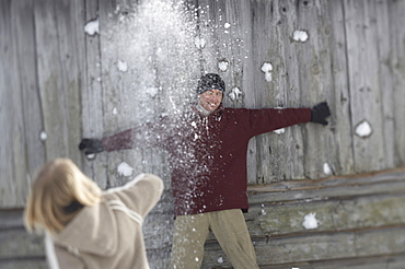 Family throwing snowballs