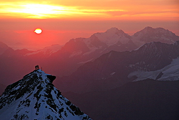 Two climbers on top of second summit of Bishornat at sunrise, Bishorn, 4135 meters, Valais, Wallis, Switzerland, Alps