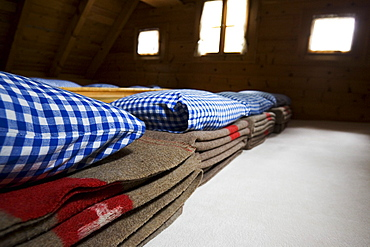 Woolen blankets in a dormatory. Cluozza hut, Cluozza Valley, Val Cluozza, Swiss Nationalpark, Engadin, Graubuenden, Grisons, Switzerland, Alps