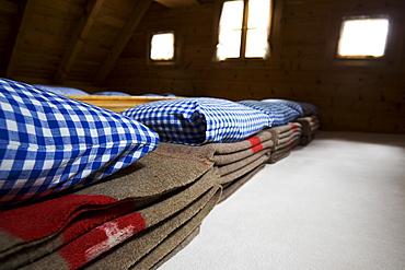 Woolen blankets in a dormatory. Cluozza hut, Cluozza Valley, Val Cluozza, Swiss Nationalpark, Engadin, Graubuenden, Grisons, Switzerland, Alps