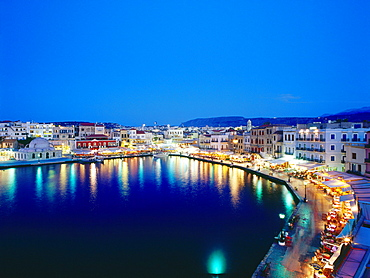 Illuminated Venetian Harbour at night with restaurants, Chania, Crete, Greece