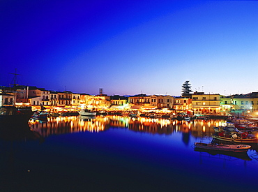 Venetian Harbour at night with restaurants, Réthimnon, Crete, Greece