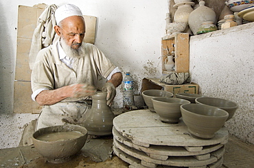 Potter at work in pottery, Fes, Morocco