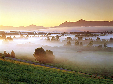 Misty landscape with Wetterstein Mountains, Upper Bavaria, Germany