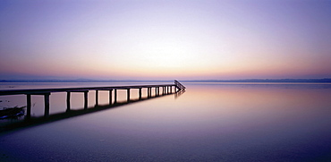 Wooden pier over body of water, St. Heinrich, Starnberger See, Upper Bavaria, Germany