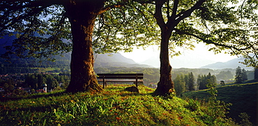 Bench and scenic mountain vista, Grainau, Upper Bavaria, Germany, rear view