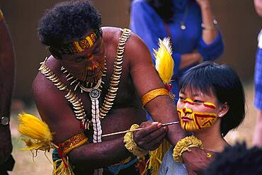 Aborigine painting the face of an Asian girl, Face paints, Royal Easter Show, Sydney, NSW, Australia
