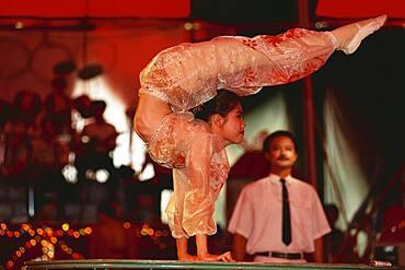 Acrobat at national circus, Saigon, Vietnam, Asia
