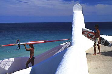 Men carrying surfboards to the sea, Sotavento de Jandia, Fuerteventura, Spain, Europe